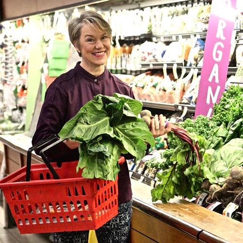 Jennifer Stack at produce counter in grocery store
