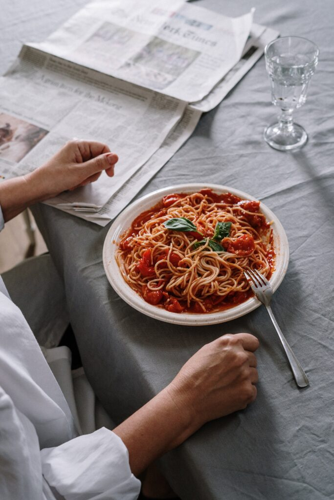 fork setting on top of a plate of spaghetti